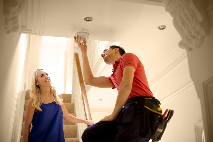 HVAC technician installing a carbon monoxide detector in Kent, Washington.