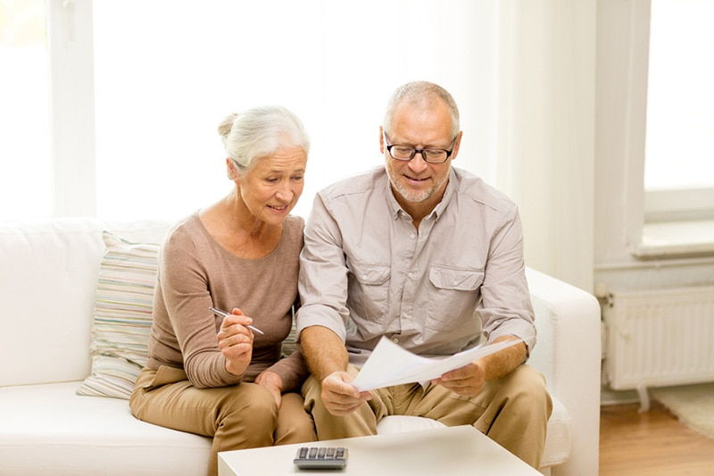 An older couple looking over papers together | What Does AFUE Mean? | Compare Furnace Efficiency | Kent, WA
